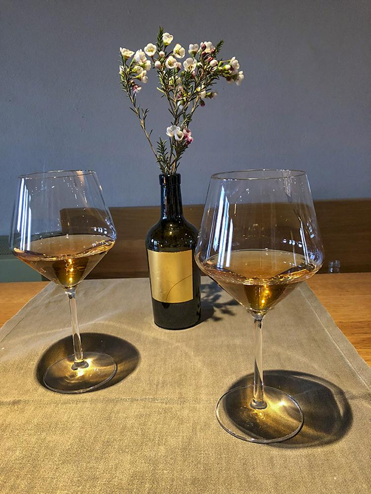 Two glasses of golden Dorona di Venezia wine